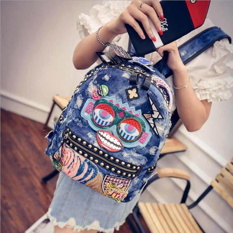 free shipping 2016 NEW cowboy rivets sequins backpack Han edition cool bag embroidered badges rivet punk