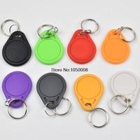 50pcs Lot T5577 Rewritable Programmable RFID 125 KHz Keychain Keyfobs Key Finder For Copy EM4100 Cards
