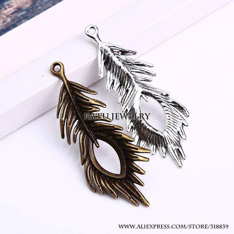 ツ)_/¯Plumas de pavo real de la vendimia Amuletos aleación del cinc ...
