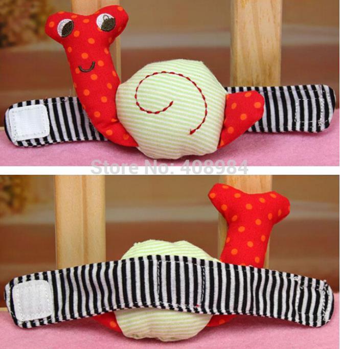 Bebé de peluche de juguete campana Caracol precioso Reloj de Pulsera Mano Sonaje