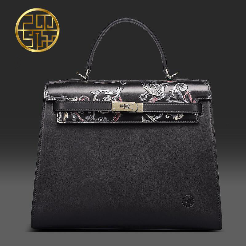 Pmsix 2017 China wind embossed leather handbag first layer of leather big bag fashion retro shoulder shoulders Messenger bag famous brand top leather handbag bag 2018 new big bag shoulder messenger bag the first layer of leather hand bag