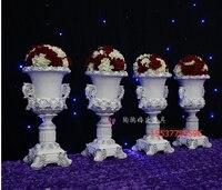 European resin pots wedding arrangements. Floral Art Decoration welcome area.