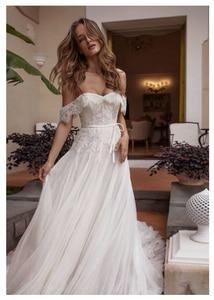 Image 1 - Vestido de novia de encaje, sin hombros, Informal, hasta el suelo, blanco marfil, para playa, elegante, 2019