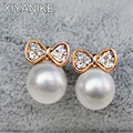 2016 New Fashion Korean Jewelry Gold Plated Butterfly Bow Knot Pearl Stud Earrings For Women Wholesale Price Brincos XY-E136