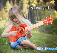 Baby guitar toys Children's first lesson in stringed instrument education toys Children learn guitar toys large sized