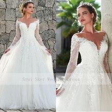 Marvelous A Line Tulle suknie Illusion dekolt suknia ślubna z długim rękawem Custom Made aplikacje Sexy powrót Vestios De Novia Bridal