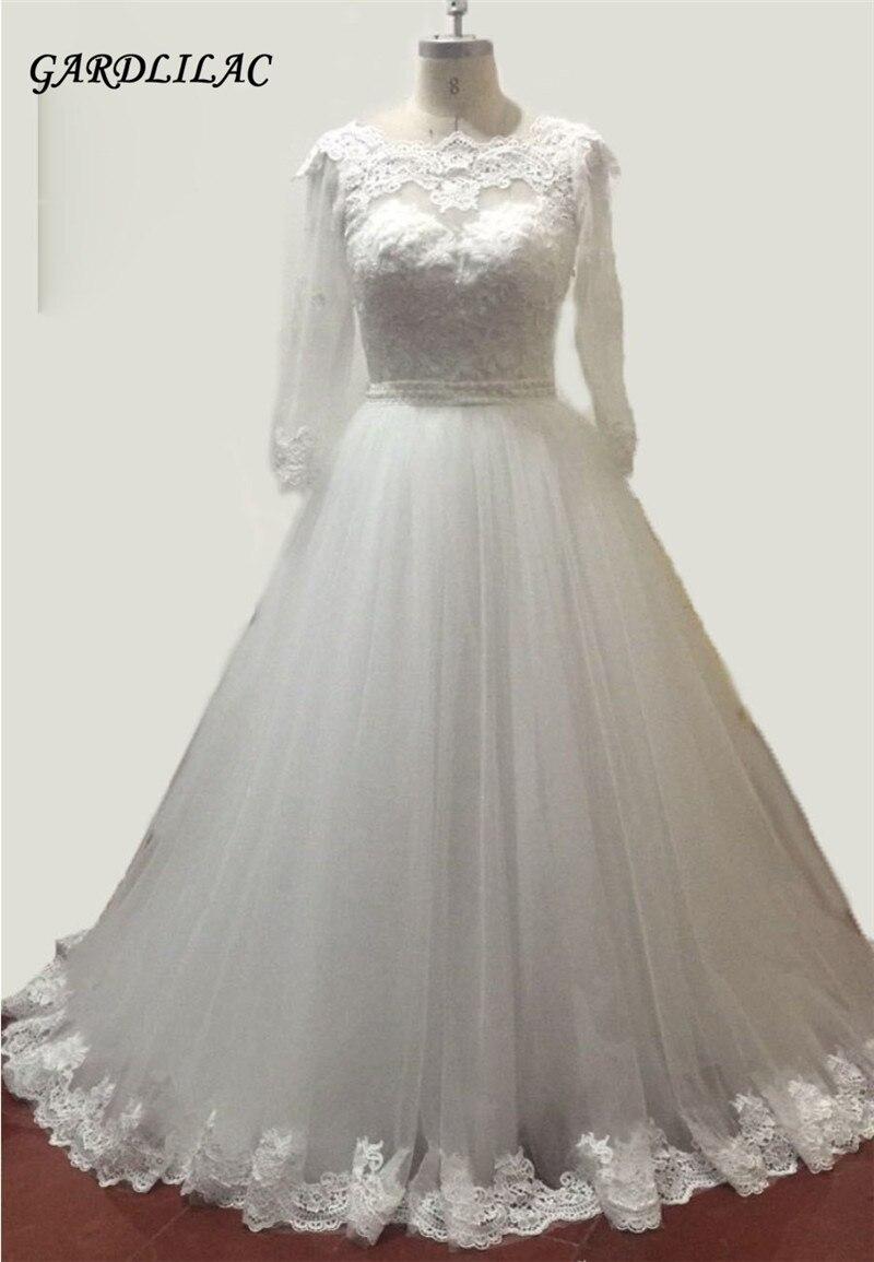 New White Elfenben Långärmad Bollkjole Bröllopsklänningar Tulle med Spetsapplikationer Plus Storlek Brudklänning Vestidos De 15 Anos