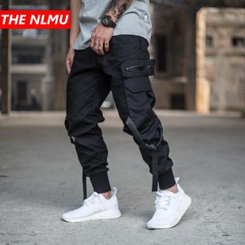 Męskie multi-pocket spodnie haremki mężczyźni Streetwear Punk spodnie cargo Hip Hop spodnie typu casual biegaczy męskie czarne spodnie GW014 tanie i dobre opinie Pełnej długości THE NLMU Cargo pants REGULAR COTTON Midweight Mieszkanie Suknem Zipper fly WJ014 Kieszenie Men Black Joggers Cargo Pants
