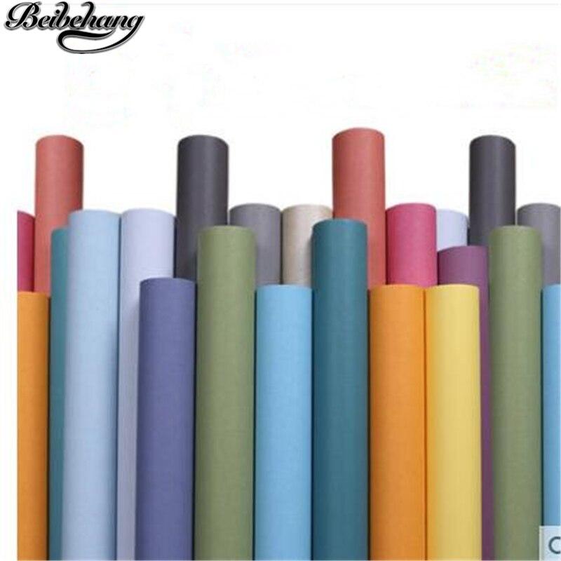 Beibehang moderne simple plaine nonwovens papier peint chambre salon couleur unie papier peint vert rose papier peint papel parede