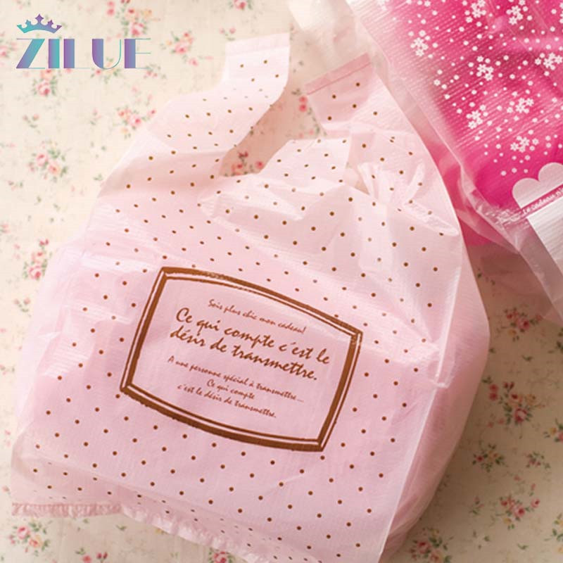 Zilue 100pcs/Lot Size 18*35cm(7*14) Shopping Plastic Bag Handle Packaging Gift Small Dot Pink Colors Cute Bag Home Supplies