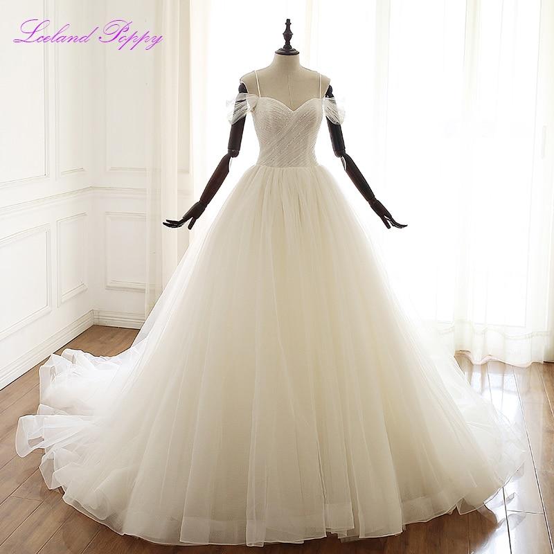Lceland Poppy Women's A-line Sleeveless Wedding Dresses 2020 Crystal Beaded Spaghetti Straps Floor Length Pleated Bridal Gowns
