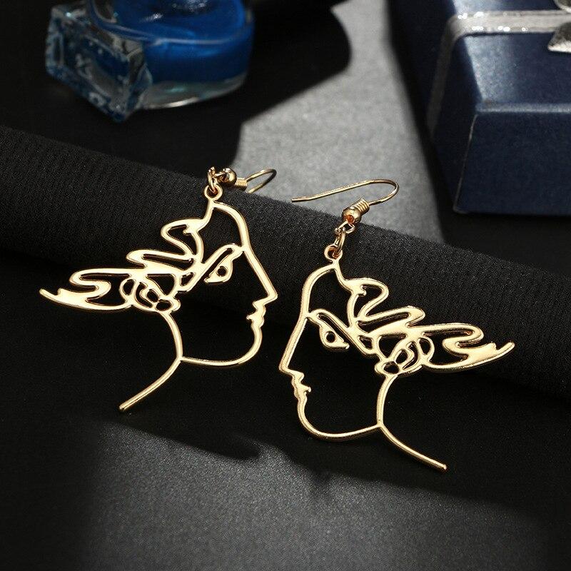 e2c2501a4fc9c Unique Charming Gold Filled hollow Face Dangle Wire Earrings Girls Artsy  Outline Long Earrings For Women Bijoux 2018-in Drop Earrings from Jewelry  ...