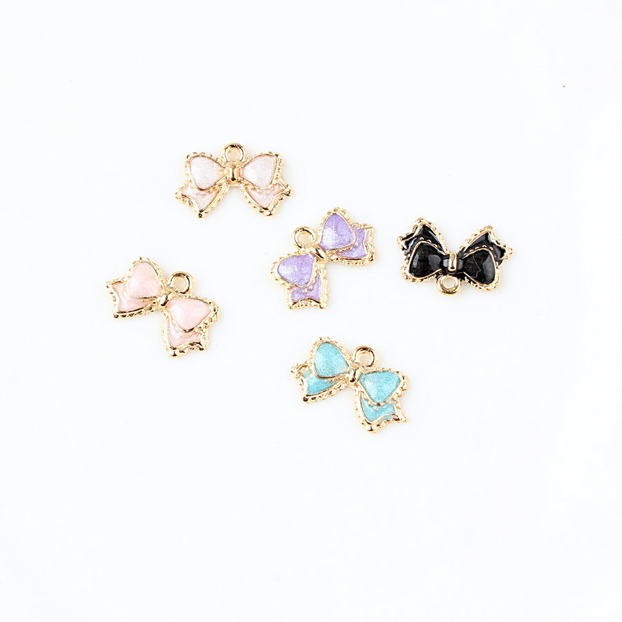 10pcs lot Fashion Beautiful Spot Bow Tie Diy Pendants Charms Oil Drop Metal Alloy Bracelet Charm in Charms from Jewelry Accessories