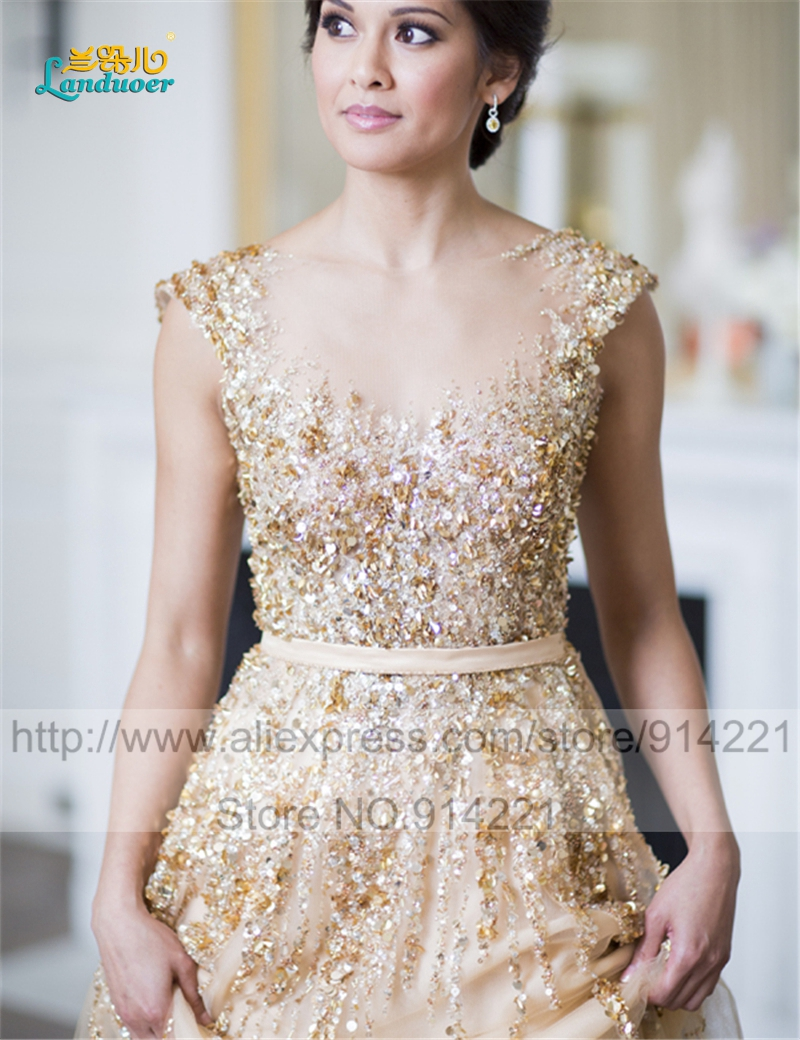 Gorgeous champagne wedding dresses 2016 sexy see through backless gorgeous champagne wedding dresses 2016 sexy see through backless gold appliques scoop beads lace wedding gowns robe de mariage in wedding dresses from ombrellifo Gallery