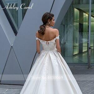 Image 4 - Ashley Carol Sexy Sweetheart Cap Mouw Backless Trouwjurk 2020 Nieuwe Luxe Kralen Sjerpen Hof Trein Prinses Bruidsjurken