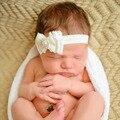 Nuevo arco del cordón del bebé diadema Baby Girl Bow vendas principales accesorios del pelo del bebé recién nacido venda del cordón del regalo del bebé lactante 2 unids