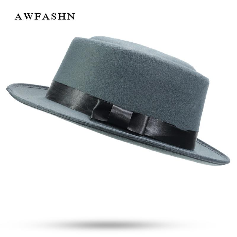 Nueva lana sombreros de ala ancha gorra de invierno sombrero de fieltro de  las mujeres hombre elegante cilindro Noble Arco Nudo hueso negro señoras  Vintage ... 48f1e5d7ff8