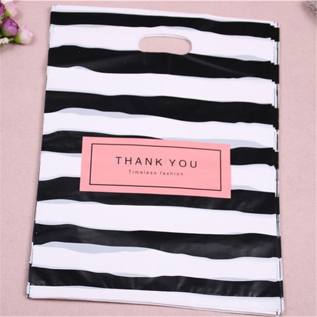 Nouveau Design en gros 100 pcs/lot 25*35cm luxe mode Shopping en plastique cadeau sacs avec merci faveur anniversaire emballage
