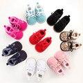 A granel 100 par/lote Nueva Caliente 9 colores de Invierno de la Felpa Sólido Recién Nacido niñas Niños Primero Walkes duro suela zapatos de bebé con cordones botas de piel