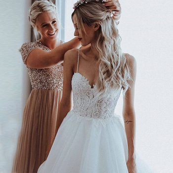 Boho A-line Wedding Dress Spaghetti Straps Appliques Beading Open Back Bridal Dress Chapel Train Elegant Backless Robe De Mariee