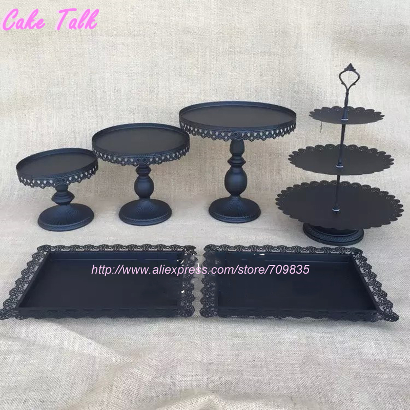 Wrought Iron 3-Tiered Cupcake, Candle, Fruit Stand, Black Tiered Cake Stand Black wrought iron 3-tiered cupcake, fruit or candle stand. Holds 18 cupcakes or pieces of fruit in three (3) tiers of 7, 6, 5 with 1 space on the top.