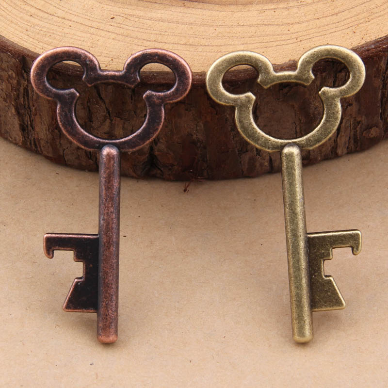 Yage 500pcs June 2015 New Design Creative Wedding Favors Party Gifts Silver Mickey Mouse Skeleton Key Beer Bottle Opener In Charms From Jewelry
