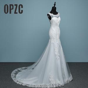 Image 1 - Pure White Ivory Luxury Sexy Backless Mermaid Small Train Lace Wedding Dress 2020 New Fashion A line Appliques Vestido De Noiva