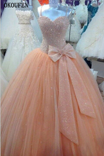 Ball Gown Quinceanera Dresses 2019 Peach Big Bow Spaghetti Straps Sweet 16 Dresses Debutante vestido de 15 anos robe de bal doce new sweet first comunion dresses for girls lace spaghetti straps sleeveless ball gown robe de communion fille blanche with bow