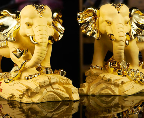 Set up a wealth of elephant velvet sand gold home decoration resin handicraft to move to the living room decorations opening gif