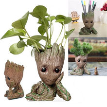 The Avengers Flowerpot Baby Action Figures Flowers pot Bruce Lee Guardians Galaxy Vessel Pen holder Grooting Toy Figures Gifts(China)
