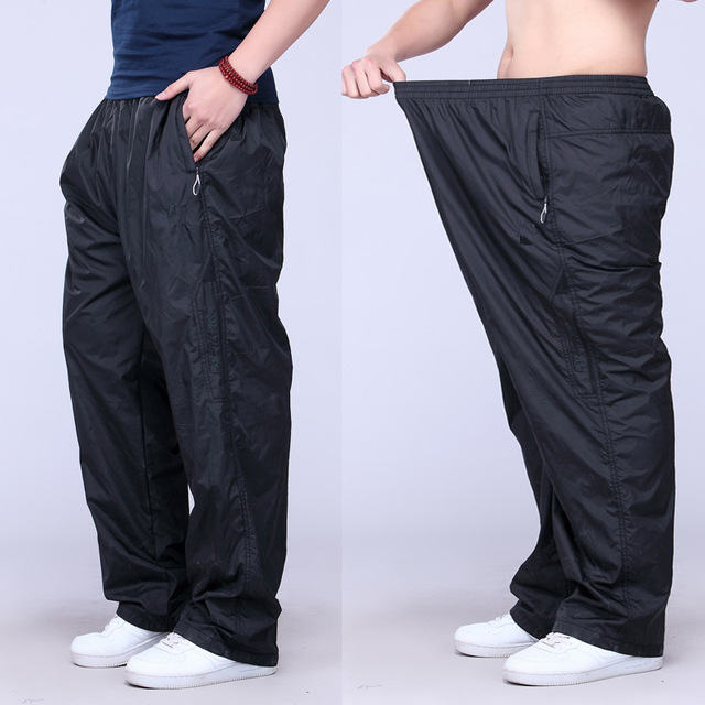 Plus Size Calças Basculador Homens Calças de Gordura Solta Dos Homens Corredores Homens 6XL Calças Casuais Com Bolsos Moda Longas Calças Dos Homens
