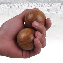 Hold the ball in a solid mahogany fitness handball elderly massage ball wood green exercise health ball