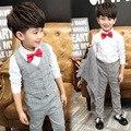 2016 Fashion Baby Boy Caballero de la Ropa Del Niño 3 Unidades A Cuadros chaleco + Pantalones + Camisa Con Corbata Niños Traje Para La Boda partido