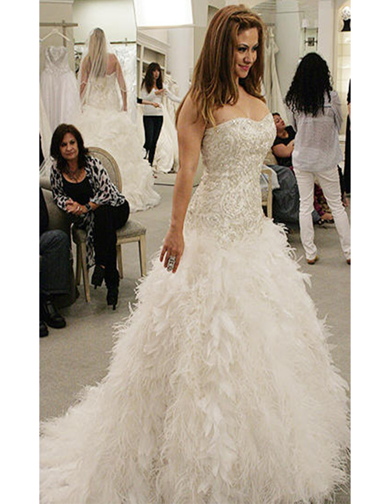 wedding dresses with feathers at the bottom wedding dress with feathers The 3rd Dress City Magazine