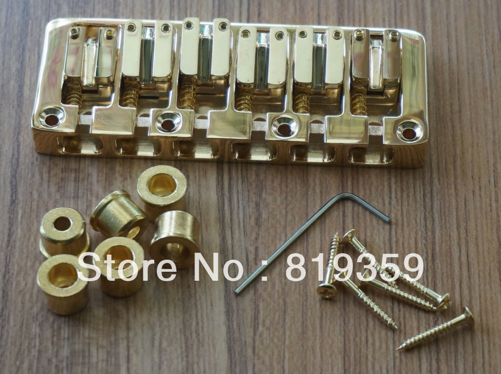 gold finished bass bridge for 6 string basses bass guitars common and string thru through body. Black Bedroom Furniture Sets. Home Design Ideas