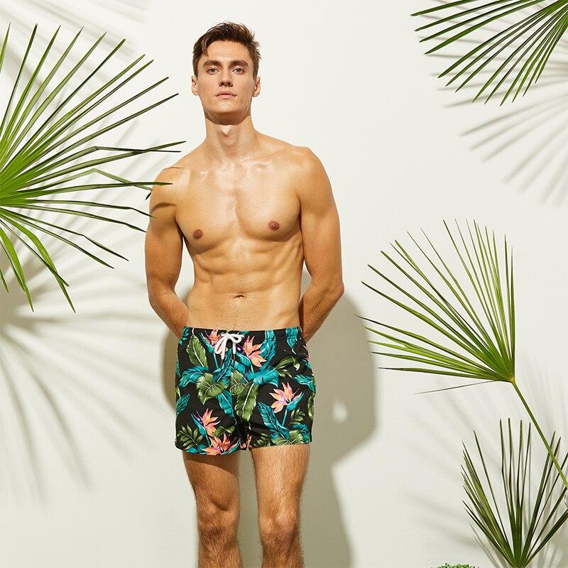 Newest Mens Black Beach Shorts Leaves Flower Printed Surfing Shorts Quick Dry Beach Pants Swim Shorts Men Swimming Shorts