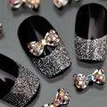 Popular 10 Unids 3D Aleación Glitter Rhinestone BowKnot Nail Art Salon Decoración Pegatinas Consejos de BRICOLAJE Decoraciones