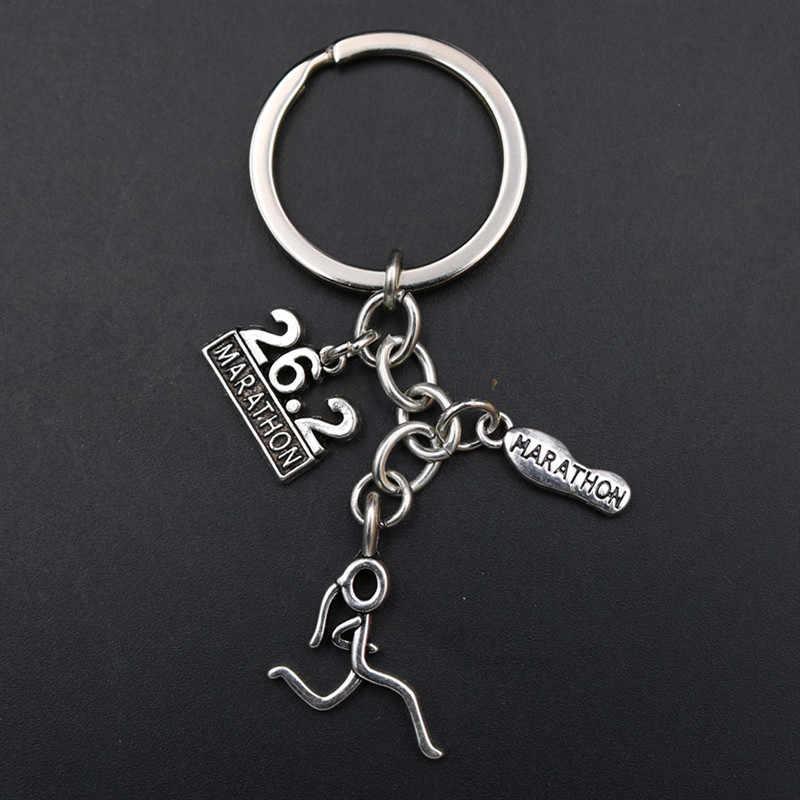 WKOUD 1 قطعة مجوهرات رياضية المفاتيح ماراثون و تشغيل فتاة و 26.2 كجم اليدوية الإبداعية ميدالية مفاتيح معدنية A1875