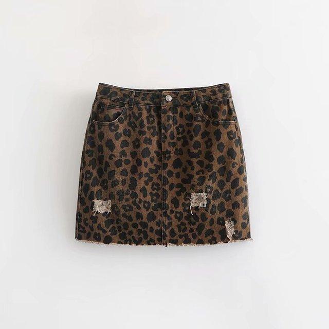 2018 mujeres leopardo vintage impresión agujero jean falda faldas mujer  alta calle vaquero roto estilo denim 471c608404b7
