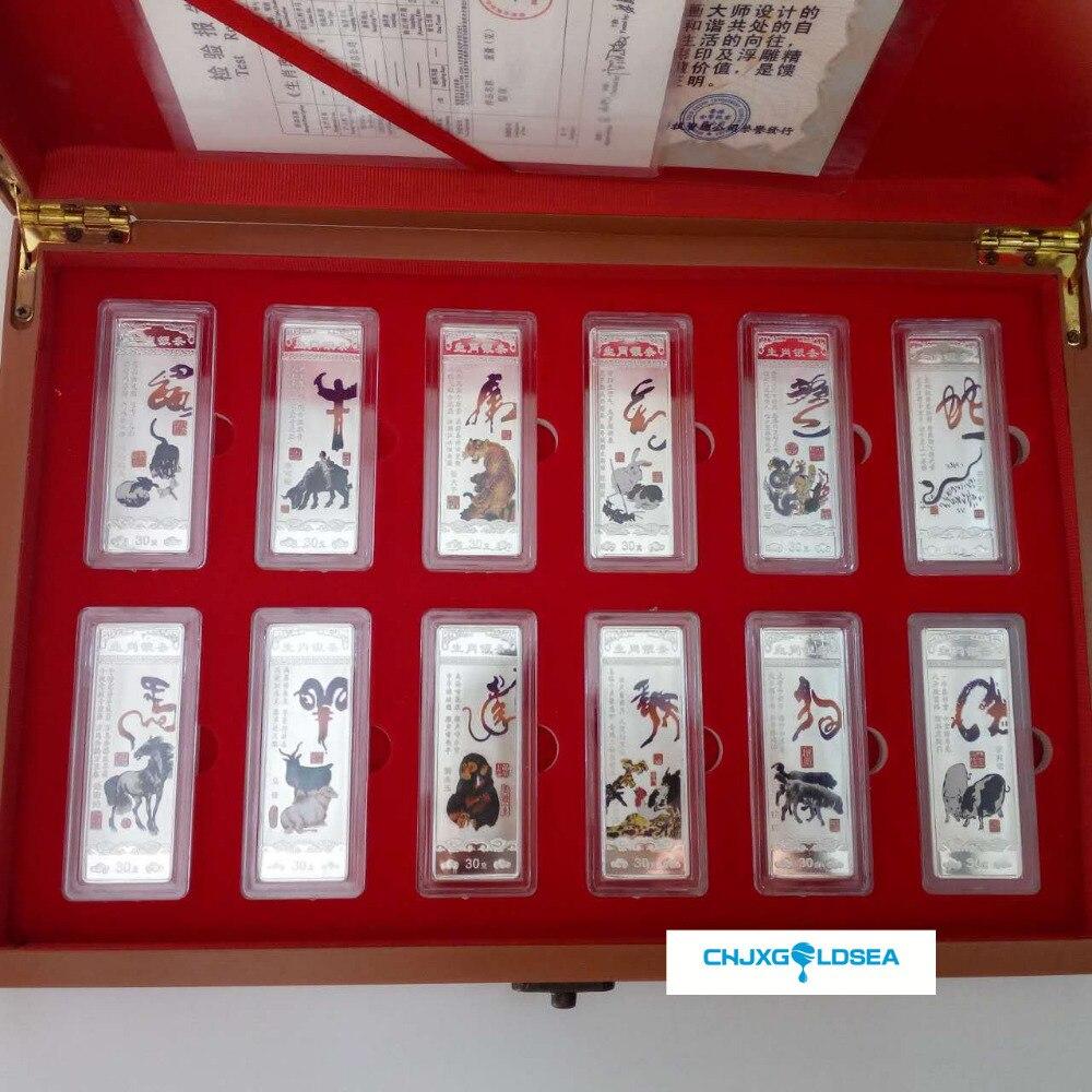 12 Zodiaco color plata barras monedas plateadas moneda regalo presente Navidad festival con caja de madera-in Monedas no convertibles from Hogar y Mascotas    1