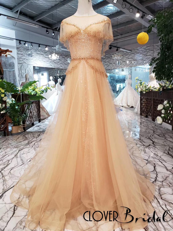Robe de mariée de haute qualité 2019 toile d'araignée perlée longue tulle nue cape top robes de bal longue