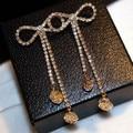 E85 arco CC Camélia Flores Tassel Longo estilo Canal Luxo Famosa Marca de Jóias brincos longos Brincos Pendurados Para As Mulheres