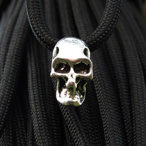 100 pcs/paquet Double trou charme métal crâne perle pour Paracord couteau longes argent