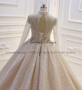 Image 4 - Amanda Design High Neck Long Sleeve Luxury Crystal Beading Shiny See Through Wedding Dress