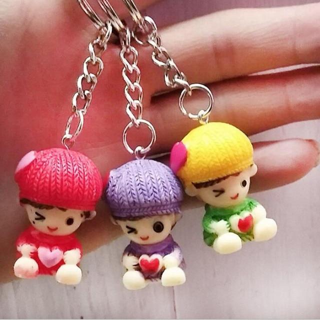Criativo pequeno presente por atacado Colorido bebê menino boneca Resina chaveiro anel chave pingente DIY Jóias Acessório novidades Atacado