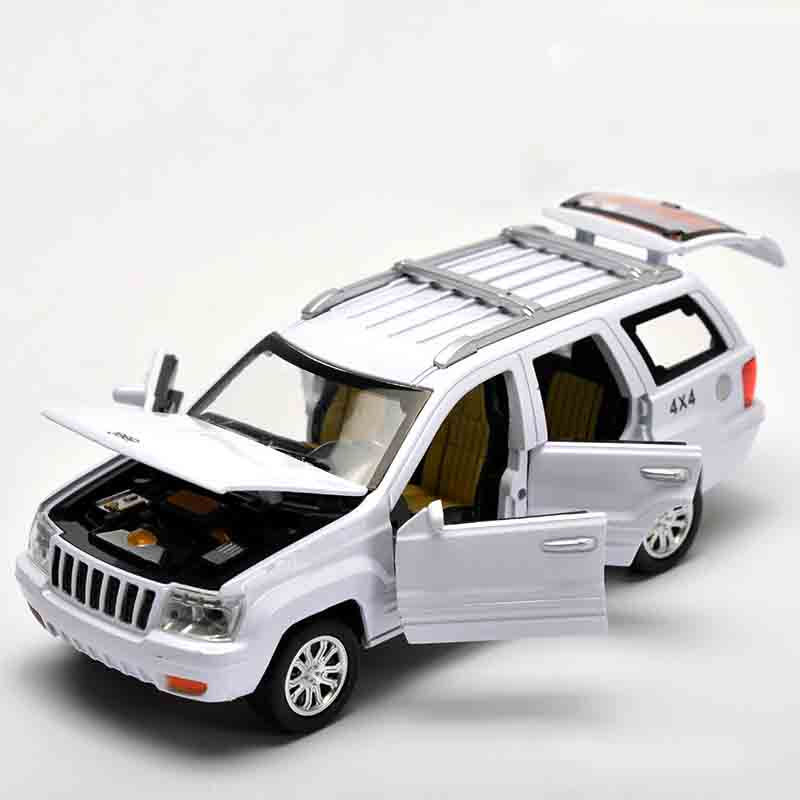 Candice guo alloy car model 1:32 Grand Cherokee for jeep plastic motor pull back sound light collection children toy birthday gi