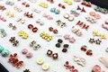 100 pares mistos estilo encantador liga Bowknots / borboleta / Cross / brincos mulheres presente das crianças YE115