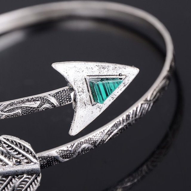 Arrow armlet with green stone. Silver color