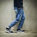 Отверстие джинсы мужские осень подросток плюс размер мужской свободный большой промежность упругие карандаш джинсы мужчины гарем хлопок джинсы