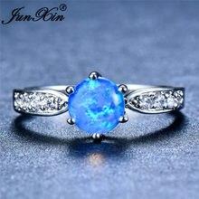 JUNXIN – bague de mariage en opale de feu à Six griffes pour femme, anneau rond blanc/bleu, couleur argent, Zircon arc-en-ciel, pierre de naissance